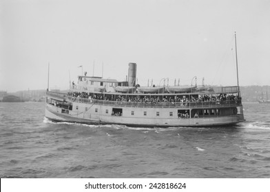 Immigrant ferry boat in New York Harbor. Ferries were used to transfer immigrants from their ocean crossing ships to Ellis Island Immigration Station, from Ellis Island to the mainland. Ca. 1910.