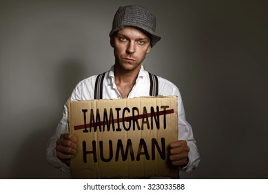 Immigrant holding protest cardboard