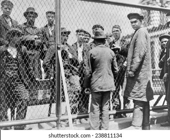 Immigration. Failed immigrants awaiting deportation on the roof of the main building at Ellis Island. Halftone photograph ca. 1902