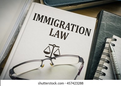 Immigration law book. Legislation and justice concept.