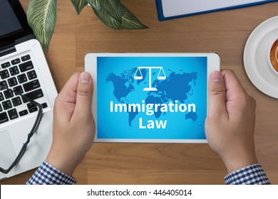 Immigration Law man hand Tablet and coffee cup