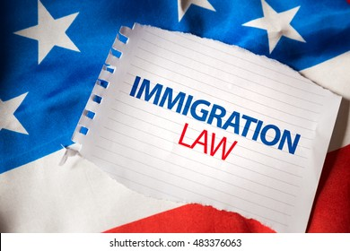 Immigration Law on notepaper and the US flag