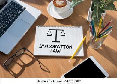 Immigration Law open book on table and coffee Business