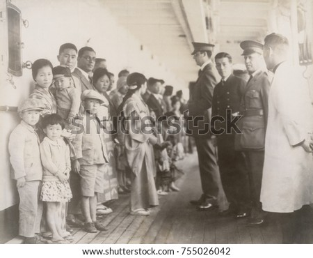Immigration officials examining Japanese passengers aboard the ship Shimyo Maru, at Angel Island 1931. Immigration Act of 1924 severely restricted Japanese immigration to the U.S. These hopeful immigr
