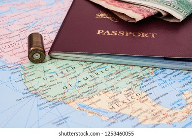 Immigration passport and 9mm bullet casing on map of the United States and Mexico