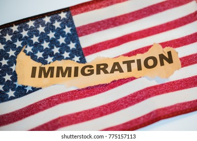 Immigration word laying on American Flag