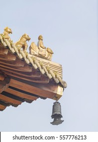 "Immortal and beasts on the eaves of the building in Shanghai Jingan temple, Imperial yellow roof decorations,copy space, the Chinese characters on chime means ""pray for every believer""."