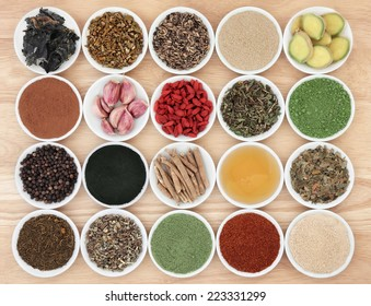 Immune boosting health food selection in porcelain dishes over beech wood background.