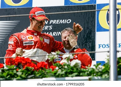 Imola, Italy. 21/23 April 2006. F1 World Championship. Grand Prix of San Marino. Michael Schumacher, Germany, Ferrari, wins the race and celebrates with Jean Todt on the podium.