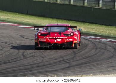 Imola, Italy - October 11, 2014: A Ferrari 458 Italia Gt3 of Baldini 27 Network Srl team, driven By Giammaria Raffaele (Ita) and Casa Lorenzo (Ita),  the C.I. Gran Turismo car racing