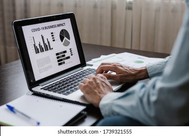 Impact of COVID-19 pandemic global economy crisis. Businessman working remotely from home. Economic crisis derived from the covid19. Business financial risk background concept.