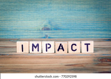 impact - name from wooden letters. Office desk, informative and communication background