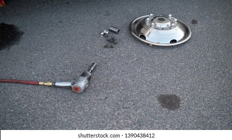 Impact Wrench Lug Nuts and Hubcap on Cement