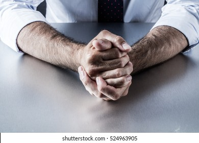 impatient bossy businessman hands and gestures holding tight expressing controlled frustration, anger and tension annoyed by management