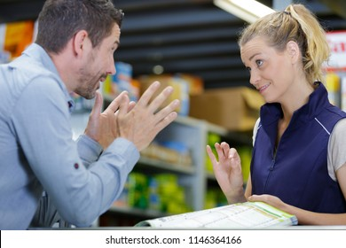 impatient customer talking to sales clerk in hardware store