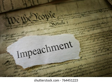 Impeachment news headline on a copy of the United States Constitution