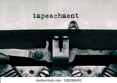 Impeachment typed on vintage typewriter - Government and Politics concept