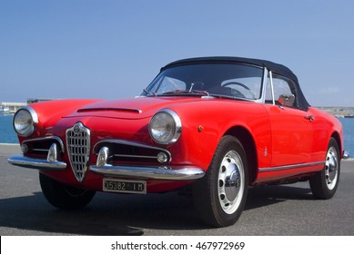 Imperia, Italy - July 29, 2016: Alfa Romeo Giulietta Spider cruising on the road in Imperia during raid of vintage cars