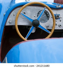 IMPERIA, ITALY - JUNE 7, 2014: Close up detail of a Classic car cruising on the road in Imperia during raid of vintage cars.