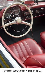 IMPERIA, ITALY - MAY 13: Interior of an old Mercedes-Benz 230 SL Roadster parked in a street in Imperia, Italy on May 13, 2011
