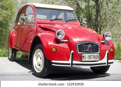 IMPERIA, ITALY � MAY 14: Close up of red Citroen car parked in a street in Imperia, Italy on May 14, 2011.