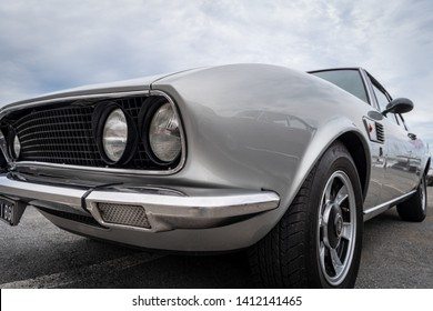 Imperia, Italy - May 17, 2019: Close up of FIAT Dino sport car parked in a street in Imperia during raid of vintage cars
