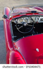 Imperia, Italy - Settember 9, 2020: Close up detail of MGA Roadster parked in a street in Imperia during raid of vintage cars