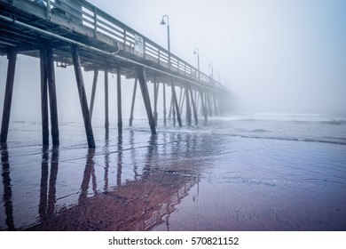 The Imperial Beach pier disappears in to the Pacific Ocean fog.