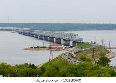 The Imperial Bridge across the Volga. A bridge across the Volga river in spring in Ulyanovsk, Russia. The view from the top of the embankment of the Volga in Ulyanovsk.