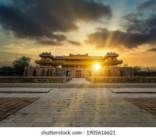 """Imperial Royal Palace of Nguyen dynasty in Hue. Beautiful view of the """" Meridian Gate Hue """" to the Imperial City with the Purple Forbidden City within the Citadel in Hue, Vietnam. Travel and landscape"""
