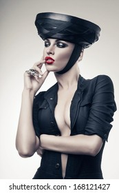 imperious strict woman in black with red lips