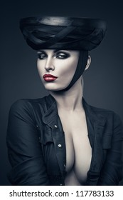imperious woman in black with red lips