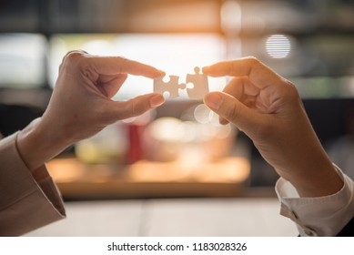 Implementation improving connections strategy team solution organization.Piece of jigsaw assembly by Implement puzzle. Hands of team connecting group of business people solutions success strategy
