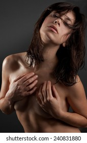 Implied Nude Woman With Body Oil