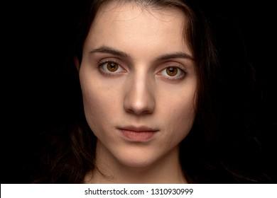 Implied Topless brunette woman on dark background