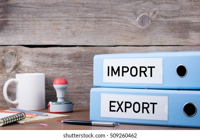 Import and Export. Two binders on desk in the office. Business background