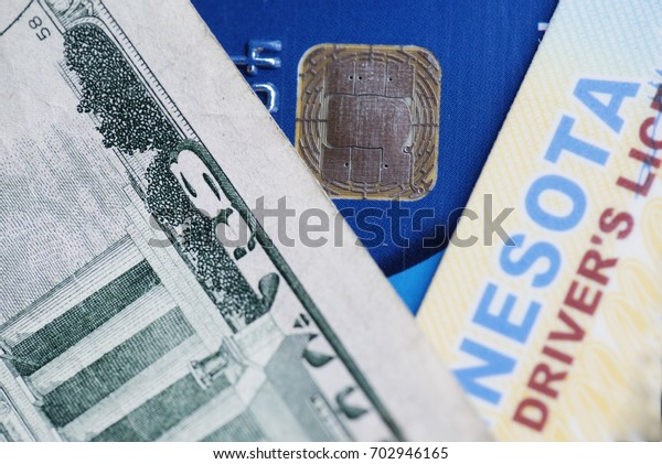 Important items in today's world, including dollar bill, credit card and drivers license.