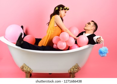 Important part of life. Bubble bath day. Beauty routine and personal hygiene. Hair grooming routine. Bathing hygiene habit. Couple in love in bath tub. Couple of mime man and sexy woman enjoy bathing.