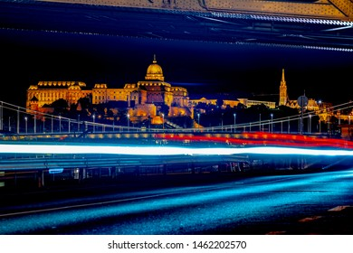 The imposing Buda Castle with the lights of the cars at night. World Heritage Site
