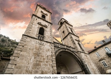 The imposing facade of the Kotor Cathedral of Saint Tryphon as storm clouds gather overhead, in the ancient city of Kotor Montenegro