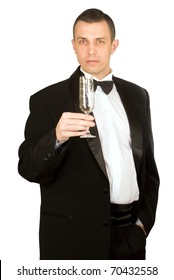 The imposing man in a classical tuxedo with a wine glass