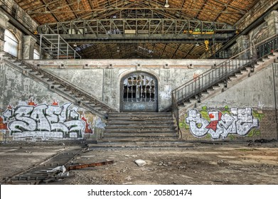 Imposing staircases inside the hall of an abandoned coal mine, HDR