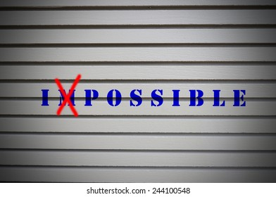 Impossible message on gray wall. Business Concept.