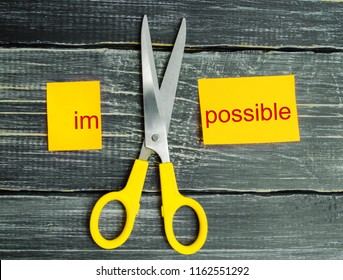 Impossible Is Possible Concept. card with the text impossible, scissors cut a word to them. success and challenge concept. I can, goal achievement, potential, overcoming