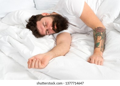 Impossible to wake up. brutal sleepy man in bedroom. asleep and awake. mature male with beard in pajama on bed. energy and tiredness. bearded man hipster sleep in morning. Too lazy to wake up.