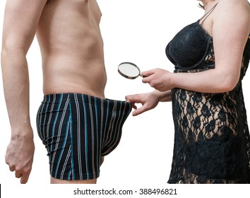 Impotence concept. Sexy woman is looking on her lovers penis with magnifying glass. Isolated on white background.