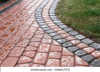 impregnated paving stones on the path not receiving rainwater