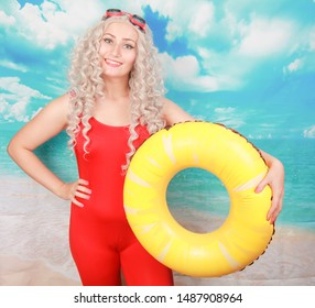 Impressed lifeguard works at beach, uses lifebuoy for saving people, wears pinup red spandex swimming overall, stands indoor, feels embarrassed. Omg and water activities concept