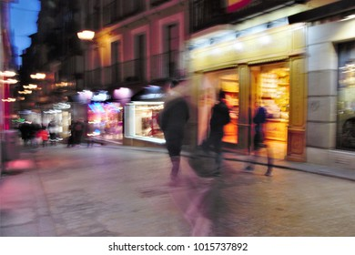 Impressionist night photography of people taken at low speed