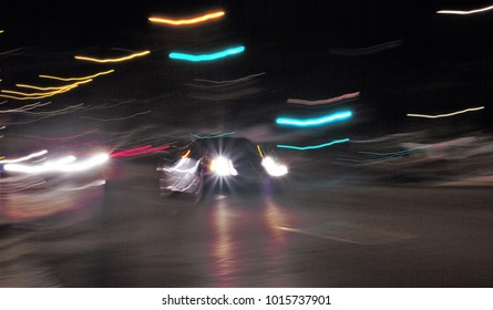 Impressionist Night photography of vehicle taken at low speed